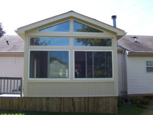 Room enclosure with sliding windows
